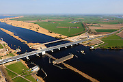 Nederland, Flevoland-Overijssel, Ramspol, 01-05-2013; nieuwe Ramspolbrug in de N50 gezien in de richting van Overijssel met naast de brug de balgstuw.  De vaargeul in het Ramsdiep met strekdam. Ramspol, inflatable dike, between Ketelmeer and Black Water. The Balgstuw (bellow barrier) is a storm barrier and consists of an inflatable dam or dyke, composed of three bellows. Usually, each bellow rests on the bottom of the water, but now the bellows are inflated  because of maintenance. luchtfoto (toeslag op standard tarieven)<br /> aerial photo (additional fee required)<br /> copyright foto/photo Siebe Swart<br /> luchtfoto (toeslag op standard tarieven)<br /> aerial photo (additional fee required)<br /> copyright foto/photo Siebe Swart