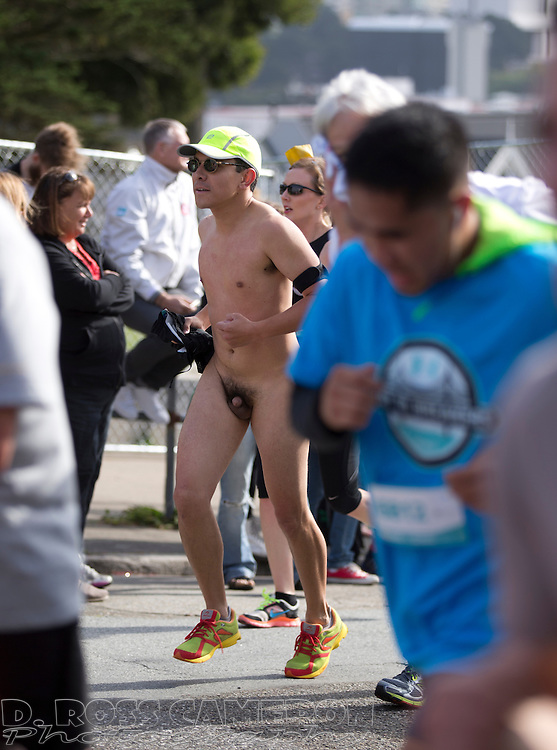 A naked runner crests the Hayes Street hill during the 103rd running of the Bay to Breakers 12K race, Sunday, May 18, 2014 in San Francisco. (Photo by D. Ross Cameron)