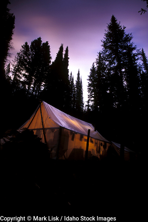 THIS PHOTO IS AVAILABLE FOR WEB DOWNLOAD ONLY. PLEASE CONTACT US FOR A LARGER PHOTO. Glowing wall tents in the Frank Church Wilderness.  MR