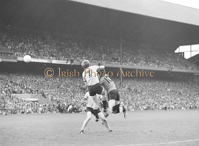 Two Dublin players take down a Kerry player as he jumps for the ball during the Kerry v Dublin All Ireland Senior Gaelic Football Final in Croke Park on the 24th of September 1978. Kerry 5-11 Dublin 0-9.