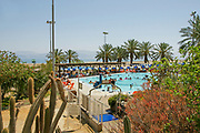 Israel, Dead Sea, Ein Gedi Resort and Spa. Holidaymakers in the thermal pool