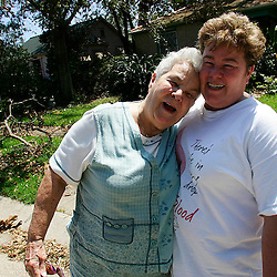 81 year-old Esther Lacoste,Left, of Metairie with her daughter Linda Reinhardt of Jefferson talk about surviving the storm and how Reinhardt had to drag her mother from her home during the storm<br /> during the aftermath of Hurricane Katrina Wednesday, September 7, 2005 in Louisiana. <br /> (Pasadena Star-News Keith Birmingham)