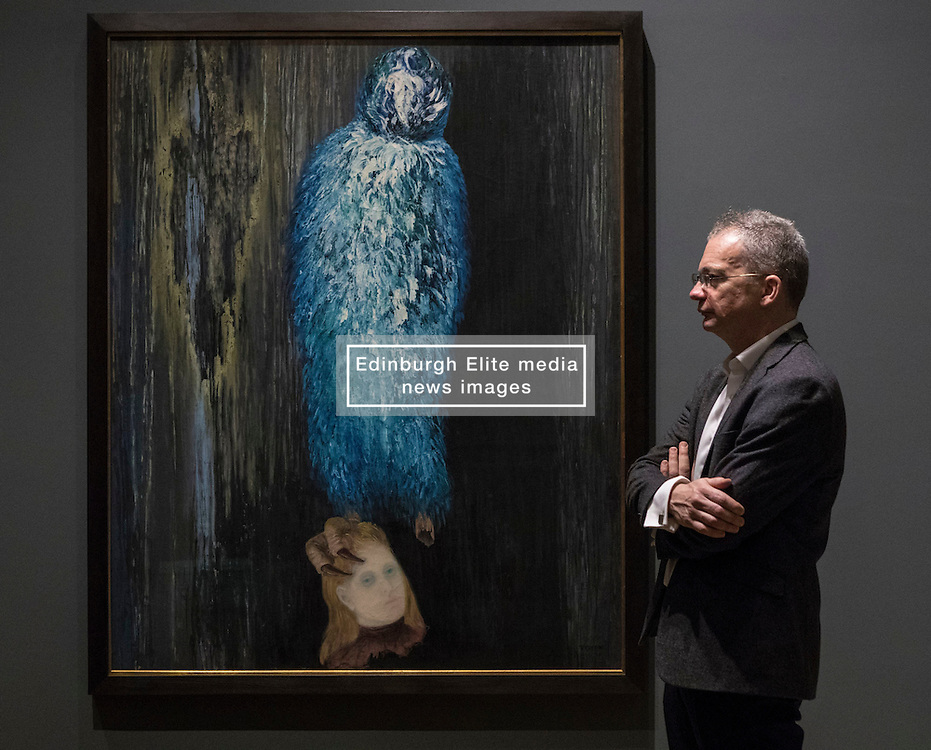 A major painting by one of the legendary figures of Surrealist art has been acquired by the Scottish National Gallery of Modern Art in Edinburgh and will go on public display for the first time this week. The Message of the Forest, which was painted in 1936, is widely acknowledged to be the greatest work by the Czech artist known as Toyen, and is the first of her paintings to enter a UK public collection.  It was acquired with support from the Walton Fund and Art Fund.<br /> <br /> Pictured: Patrick Elliott, Chief Curator at the Scottish National Gallery of Modern Art with The Message of the Forest