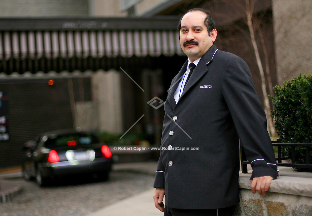 Edward Bonilla, doorman at 300 East 74th Street, poses for a portrait Thurs. April 13, 2006.