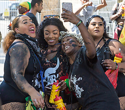 London, August 27 2017. Women take a selfie as Family Day of the Notting Hill Carnival gets underway. The Notting Hill Carnival is Europe's biggest street party held over two days of the bank holiday weekend, attracting over a million people. © Paul Davey.