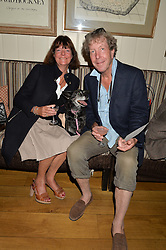 TIM & SOPHIA BEDDOW and their dog Dolly at A Date With Your Dog At George in aid of the Dogs Trust held at George, 87-88 Mount Street, London on 9th September 2014.