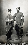 two young adult men posing in military uniform France 1914