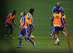 © Licensed to London News Pictures. 22/12/2015. London, UK. Chelsea football club interim manager Guus Hiddink (R) looks on as John Terry (L) reacts to a tackle during a training session at the club's Cobham ground. Photo credit: Peter Macdiarmid/LNP