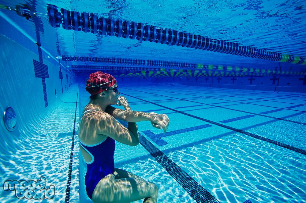 Swimmer Resting Underwater