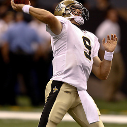 August 27, 2010; New Orleans, LA, USA; New Orleans Saints quarterback Drew Brees (9) passes during the first half of a preseason game at the Louisiana Superdome. The New Orleans Saints defeated the San Diego Chargers 36-21. Mandatory Credit: Derick E. Hingle