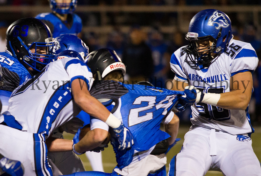 Harrisonville's Allex Sterner pulls Gavin Oyler's Grain Valley jersey Friday night. The Wildcats beat Grain Valley 24-21 for the Class 4, District 6 championship.