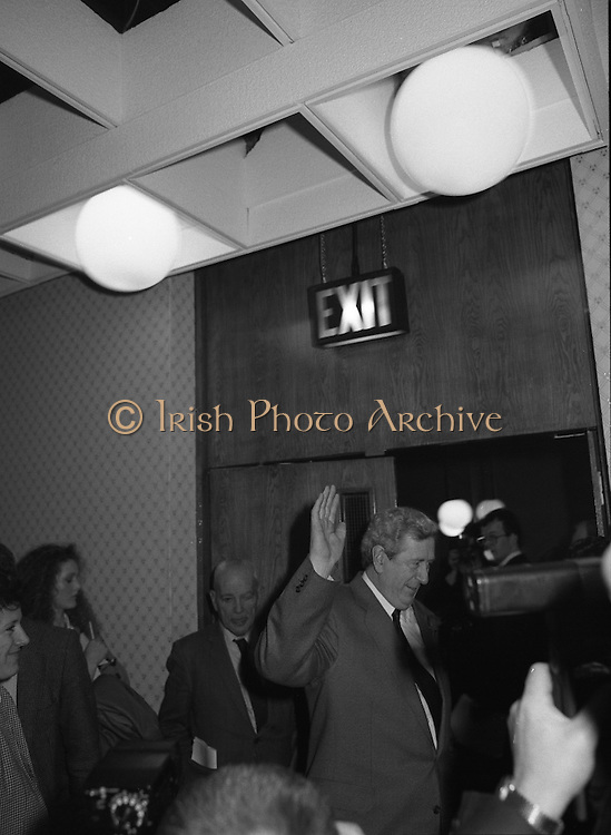 Garret Fitzgerald Stands Down As Fine Gael Leader.(R52)..1987..11.03.1987..03.11.1987..11th March 1987..After the loss at the recent general election Dr Garret Fitzgerald took the decision to resign as leader of the Fine Gael Party...Dr Fitzgerald is pictured waving goodbye as he departs the press conference confirming his decision to resign as Fine Gael leader.