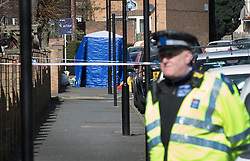 © Licensed to London News Pictures. 26/03/2018. London, UK. An evidence tent cover an area where a man was shot in Hackney. A murder investigation has been launched after a 26-year-old man was discovered in the street suffering from gunshot wounds on Sunday night. Despite the best efforts of paramedics, he was pronounced dead at the scene. Photo credit: Peter Macdiarmid/LNP