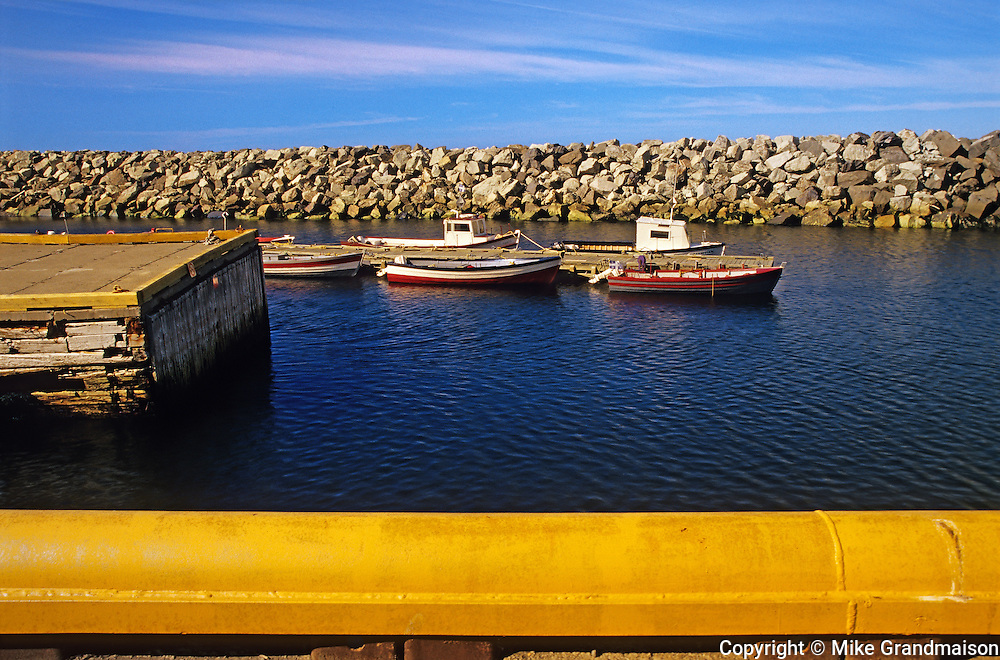 Fishing boats on shore of Gulf of St. Lawrence ( Atlantic Ocean). <br /> <br /> Quebec<br /> Canada