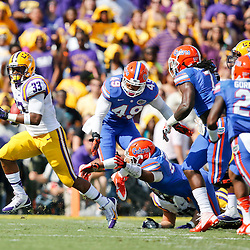Oct 12, 2013; Baton Rouge, LA, USA; LSU Tigers running back Jeremy Hill (33) runs against the Florida Gators during the first quarter of a game at Tiger Stadium. Mandatory Credit: Derick E. Hingle-USA TODAY Sports