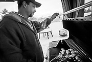 Clint Ellis puts some chicken on the grill while cooking dinner for his family at their Logan home, Monday, Jan. 14, 2013. While Ellis was serving four years in prison for producing methamphetamine, he took a two-year certification course in culinary arts and loves to cook for his family.