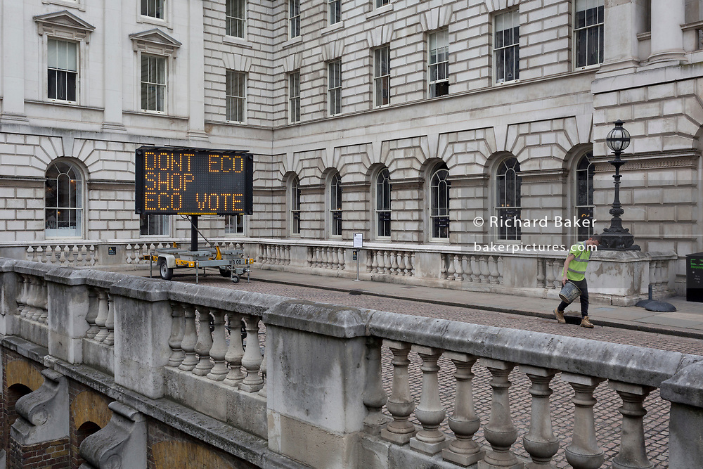 Matrix messages by Climate Change activists with Extinction Rebellion appear at Somerset House at the northern end of Waterloo Bridge as part of a protest for a better future for planet Earth after blocking the Thames crossing and as part of a multi-location 5-day Easter protest around the capital, on 16th April 2019, in London, England.