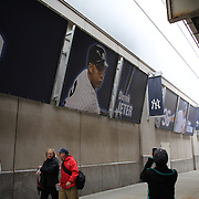 Fans arriving at Yankee Stadium  for the New York Yankees V Baltimore Orioles home opening day at Yankee Stadium, The Bronx, New York. 7th April 2014. Photo Tim Clayton