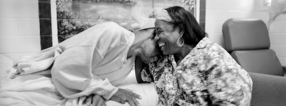 Jimmie Burnett, left, laughs with his mother, Buerat Coleman, who is visiting him in his hospice room. Coleman, 75, has to travel five hours from Shreveport, LA to visit her son and the journey is difficult for her. But their visits lift Burnett's spirits. ?It lifts me all the way up!? Burnett says. ?For the rest of this week and part of next week, I'll be good to go. Sure will.?