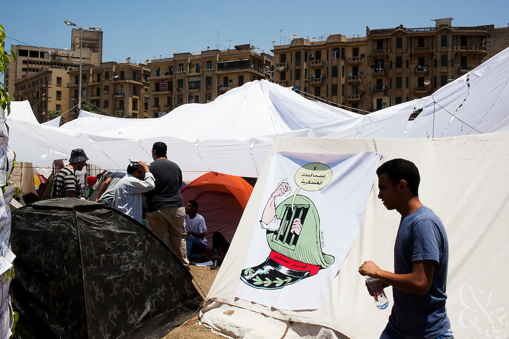 Egyptian men are seen in a tent camp for the  large July 8, 2011 protest in Tahrir Square in downtown Cairo, Egypt. Many of the protesters have vowed to stay in the square until the demands of the revolution are met, including an end to military trials of civilians, prosecution of police officers accused of murder or torture and open trials of former regime officials including ex-President Hosni Mubarak. (Photo by Scott Nelson/Der Spiegel)