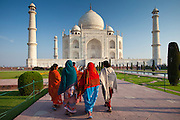 Indian tourists visiting The Taj Mahal mausoleum approach the southern view, Uttar Pradesh, India