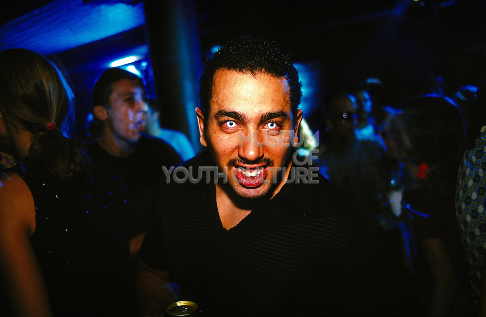 Man wearing coloured contact lenses in a club, Sao Paolo, Brazil, 2000's