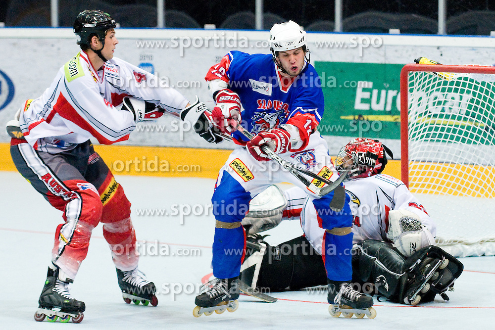 Rok Ticar, 12, of Slovenia vs Mario Altmann at Game 10 of IIHF In-Line Hockey World Championships Top Division Group match between National teams of Slovenia and Austria on June 30, 2010, in Karlstad, Sweden. (Photo by Matic Klansek Velej / Sportida)