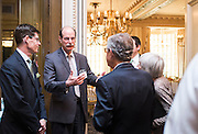 Voinovich School founding dean Mark Weinberg, second from left, chats with former Ohio Senator George Voinovich following the Ohio University State Government Alumni Luncheon on Tuesday, May 5, 2015.  Photo by Ohio University  /  Rob Hardin