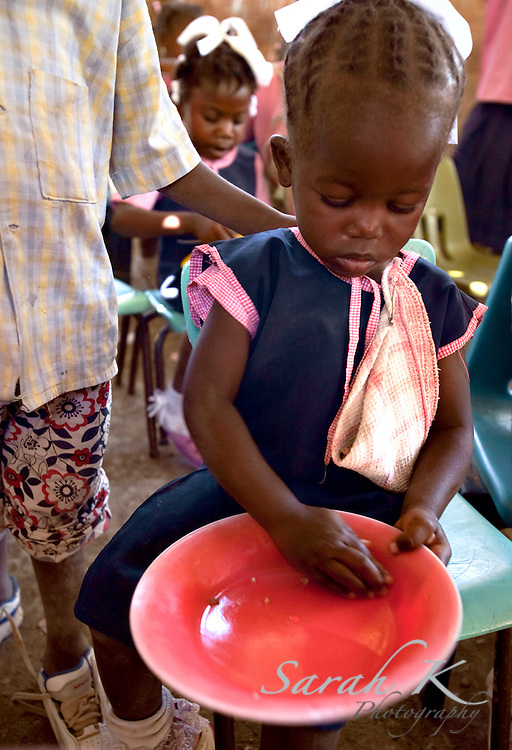Children living in the villages of Bayonnais travel through the mountains, sometimes walking for hours, to attend the school that is run by International Christian Development Mission, Inc., an organization focusing on development work in the rural community of Bayonnais. Along with providing a daily meal for the children, ICDM helps children receive an education through its child sponsorship ministry, in hopes of providing them with a better future.
