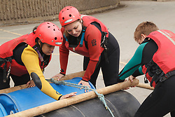 Group of visually impaired people doing raft-building activity at the National Water Sports Centre.