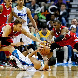 Mar 27, 2013; New Orleans, LA, USA; Los Angeles Clippers power forward Blake Griffin (32) and point guard Chris Paul (3) scramble for possession of the ball with New Orleans Hornets point guard Greivis Vasquez (21) during the second half of a game at the New Orleans Arena. The Clippers defeated the Hornets 105-91. Mandatory Credit: Derick E. Hingle-USA TODAY Sports