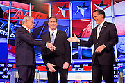 "22 FEBRUARY 2012 - MESA, AZ:  Congressman RON PAUL (left) shakes hands with Senator RICK SANTORUM and Governor MITT ROMNEY at the Arizona Republican Presidential Debate in the Mesa Arts Center in Mesa, AZ, Wednesday. It is the last debate before the Michigan and Arizona Republican primaries on Feb. 28 and ""Super Tuesday"" on March 6. PHOTO BY JACK KURTZ"