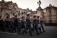 Police march past the Palacio de Gobierno on Saturday, Apr. 11, 2009 in Lima, Peru.