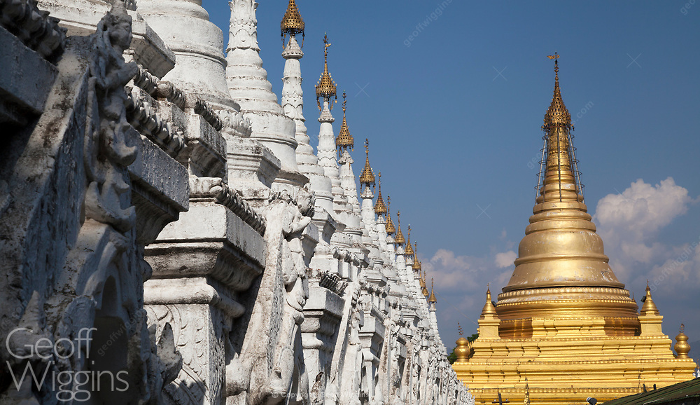 Spires of the Golden pagoda of Sandamuni Paya, Mandalay. Within 1774 slabs inscribed with Buddhist teachings. Spires of the Golden pagoda of Sandamuni Paya, Mandalay. Within lay 1774 slabs inscribed with Buddhist scriptures. these stone tablets are often deemed the 'World's Biggest Book'.
