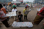 A boy sells newspapers in downtown Sonargaon, outside Dhaka, Bangladesh.