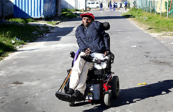 Cape Town-180815-Thozi Mciki (50) one of the people that suffers from the rarest, most disabling genetic conditions known to medicine,Fibrodysplasia ossificans progressiva (FOP) causes bone to form in muscles, tendons, ligaments and other connective tissues. Bridges of extra bone develop across joints, progressively restricting movement and forming a second skeleton that imprisons the body in bone. There are no other known examples in medicine of one normal organ system turning into another.In the picture Thozi sits in his wheechair making his way home from the disabled centre in Gugulethu. Pictures:Brendan Magaar/African News Agency (ANA)