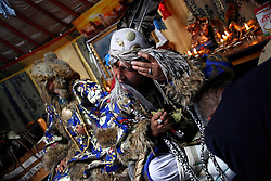 Mongolian Shaman Batgerel Batmunkh (C) blessed a knife with his tongue for a healing ritual as a worshipper kneels in front of him while his brother Gankhuyag (L) looks on during a Shaman ceremony in their ger on the outskirts of Ulan Bator, Mongolia, 04 July 2012. Mongolian brothers Gankhuyag and Batgerel Batmunkh share a similar fate. Both were construction workers before fate calls on them to take on their Shamanic roles to serve the spirits. Shamanism comes from the term 'shamans' that refers to priests or mediums that acts as vessels for spirits, gods and demons to communicate with the human world. In Mongolia, they adhere to the ancient beliefs of Tengrism, where spirits live in all of nature, in the sun, moon, lakes, rivers, mountains, and trees.
