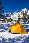 Yellow dome tent under the Tetons in winter, Grand Teton National Park, Wyoming USA