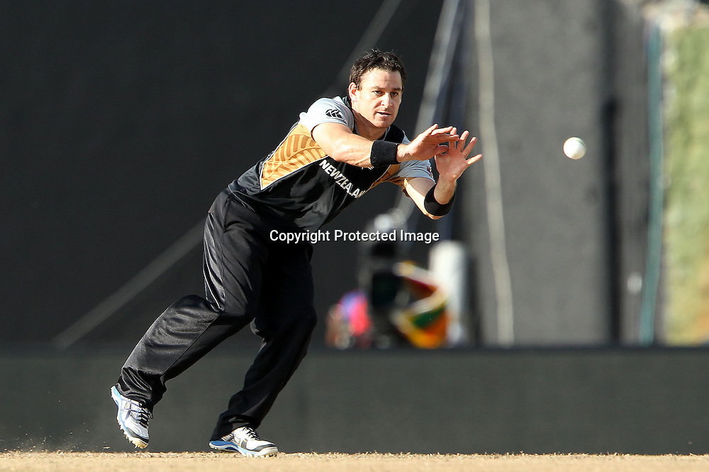 Nathan McCullum fields from his own bowling during the ICC World Twenty20 Super Eights match between The West Indies and New Zealand held at the  Pallekele Stadium in Kandy, Sri Lanka on the 1st October 2012<br /> <br /> Photo by Ron Gaunt/SPORTZPICS/PHOTOSPORT