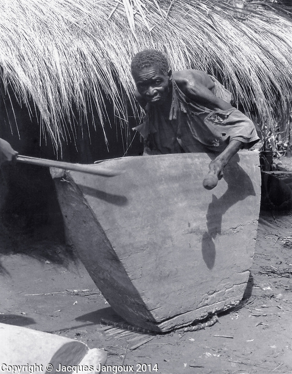 Slit drum played for Luba traditional diviners, Kaluanzo, Katanga Province, then Belgian Congo, now Democratic Republic of the Congo (1959)