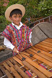 Central America, Guatemala, Antigua, boy in traditional clothing playing marimba