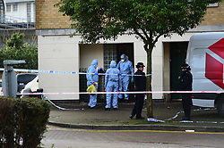© Licensed to London News Pictures. 20/12/2019. London UK: Police and forensic officers at property in Hanameel street, Silvertown in Newham, East London after a male in his late twenties was found with stab wounds, Paramedics pronounced him dead at around 2.45 this morning. Detectives have arrested a male in connection with the investigation, Photo credit: Steve Poston/LNP