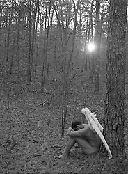 naked man with angel wings resting in the woods of East Hampton,NY