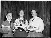 07/11/1959<br /> 11/07/1959<br /> 07 November 1959<br /> All Ireland Final of Gael Linn Children's Singing Competition at Francis  Xavier Hall, Dublin. Picture shows the prize winners of the competition: Aine Ní Rinn of Millstreet, Co. Cork (centre) 1st prize winner with her solid silver cup; Marie Ní Dhoibhlinn of Cork, 2nd prize winner with her gold medal and Liam Newman of Cabra, Dublin (3rd) with his silver medal.