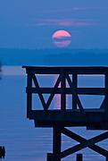 Orange glowing sun at sunrise off the pier at Reel Foot Lake, near Tiptonville, TN. Reel Foot Lake