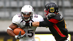 10.07.2011, Tivoli Stadion, Innsbruck, AUT, American Football WM 2011, Group A, Germany (GER) vs United States of America (USA), im Bild tackle from Roman Solovij (Germany, #4, DB) against Da'Shawn Thomas (USA, #25, RB)  // during the American Football World Championship 2011 Group A game, Germany vs USA, at Tivoli Stadion, Innsbruck, 2011-07-10, EXPA Pictures © 2011, PhotoCredit: EXPA/ T. Haumer