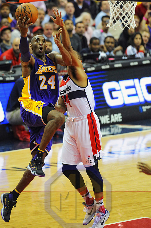 02 December 2015:  Los Angeles Lakers forward Kobe Bryant (24) in action against Washington Wizards guard Gary Neal (14) at the Verizon Center in Washington, D.C. where the Los Angeles Lakers defeated the Washington Wizards, 108-104.  (Photograph by Mark Goldman/Goldminephotos)