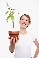 Woman Holding Potted Plant half-length