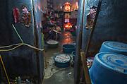 A man prepares tofu in his home in Bangkok's Chinatown
