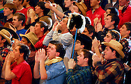 4 JAN. 2011 -- ST. LOUIS -- Chaminade Prep fans cheer for the Red Devils in the second half of Chaminade's Metro Catholic Conference game with CBC High School at CBC in St. Louis Tuesday, Jan. 4, 2011. Chaminade topped CBC 66-56. Image (c) copyright 2011 Sid Hastings.